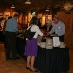 Guests enjoying the delicious buffet, provided by Mccormick & Schmick's.
