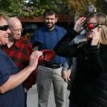 Beth Jurco explaining vision simulation goggles