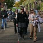 White Cane Walk group crossing the Riverfront Park bridge