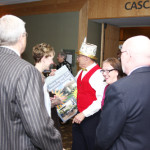 Volunteer Ronald Ross gets Luncheon guests excited about the Braille Raffle