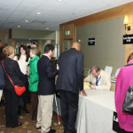 Guests checking in to the 2013 Redefining Vision Luncheon