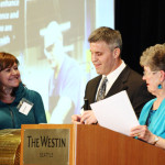 Keynote Speaker Brett Lewis selects the winner of the Braille Raffle prize