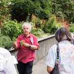 King County Master Gardener Helen Weber leading a guided tour at Redefining Vision In Bloom