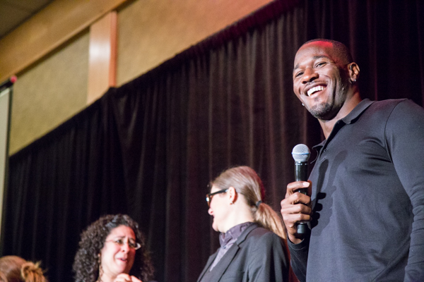Featured guest Derrick Coleman, Jr. of the Seattle Seahawks (right) speaking during the Luncheon