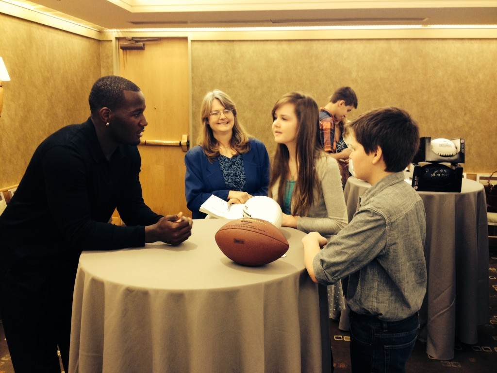 Seahawk Derrick Coleman, Jr. at the Meet and Greet portion of the Redefining Vision Luncheon