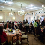 Guests gather at the Redefining Vision Holiday Breakfast