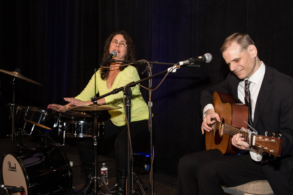 Lighthouse employees Peggy Martinez (left) and Andrew Stauffer (right) provided some musical entertainment for guests at the Redefining Vision Luncheon.