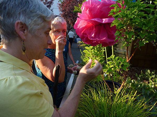 Guests experiencing the fragrant plants at the Redefining Vision Garden Party