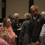 Event guests greeting Keynote Speaker Jake Olson